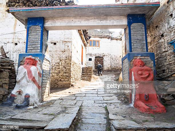 Nepal, Mustang, Jharkot: Naked male and female animist town protector deities at village gate