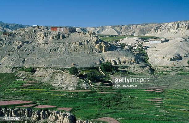 Nepal Mustang Namgyal Namgyal Gompa on steep eroded hilltop above cultivated fields