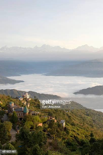 Nepal Nagarkot View across clouded valley towards Himalayan mountains
