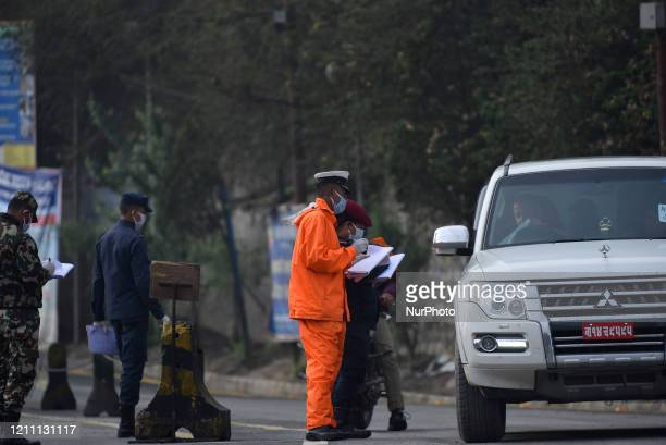 Nepal Police personnel checking driving permit during complete nation lockdown as concerns about the spread of Corona Virus at Thankot, Kathmandu,...