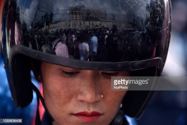 A Nepal Police women giving security around the mass rally of 13yrs old Nirmala Panta who was raped and murdered 50 days ago in Kanchanpur district...