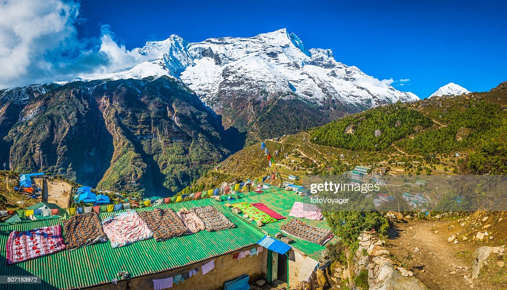 Nepal prayer flags teahouses Namche Bazaar Sherpa village Himalaya mountains : Stock Photo