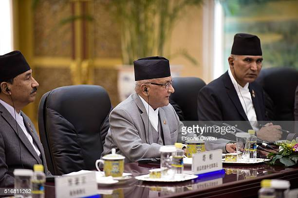 Nepal Prime Minister Khadga Prasad Sharma Oli speaks with Chinese President Xi Jinping during a conference in the Great Hall of the People on March...