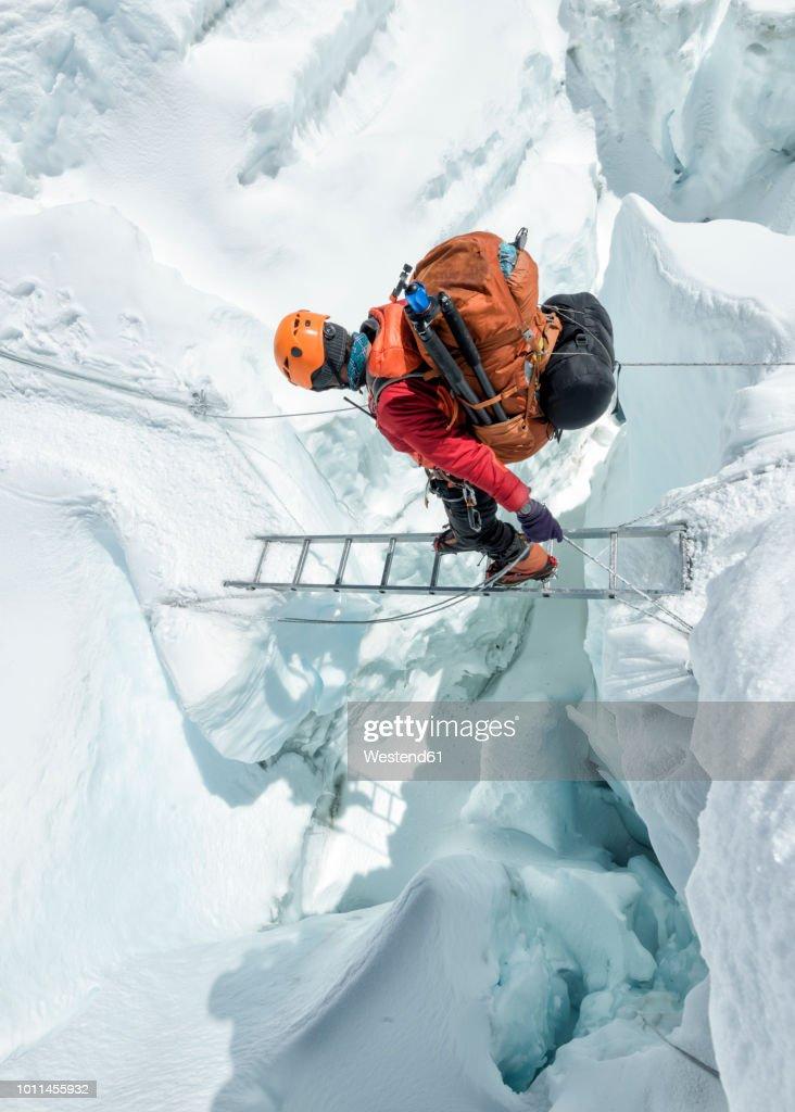 Nepal, Solo Khumbu, Everest, Sagamartha National Park, Mountaineer crossing icefall at Western Cwm : Stock Photo