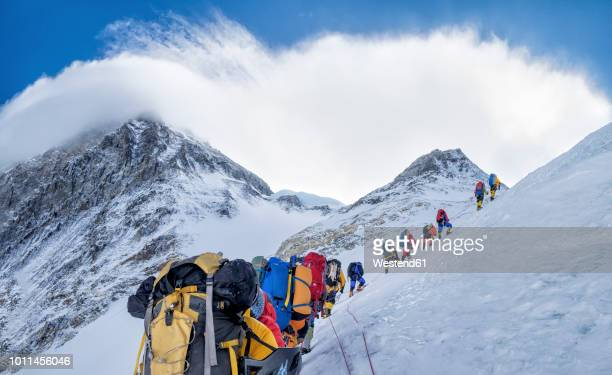 nepal, solo khumbu, everest, sagamartha national park, roped team ascending, wearing oxigen masks - mountain peak stock pictures, royalty-free photos & images