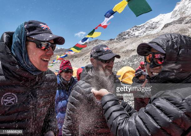 nepal, solo khumbu, group of mountaineers at  the everest base camp - base camp stock pictures, royalty-free photos & images