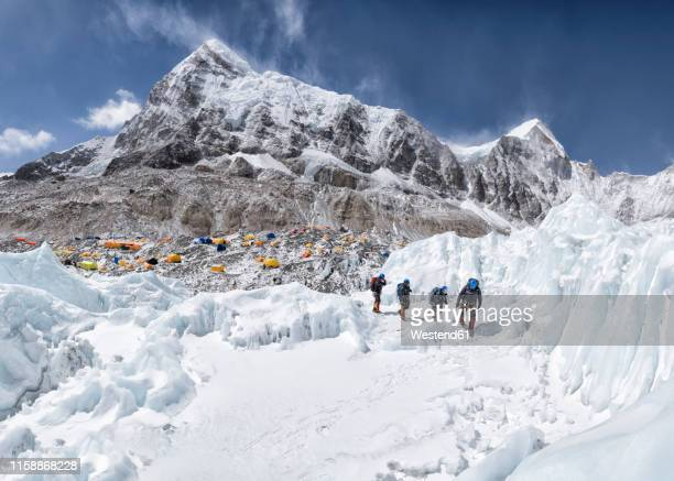 nepal, solo khumbu, mountaineers coming from everest base camp - base camp stock pictures, royalty-free photos & images