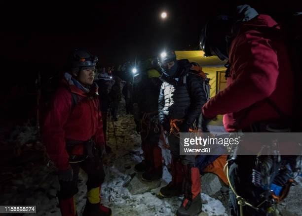 nepal, solo khumbu, mountaineers returning tp everest base camp at night - base camp stock pictures, royalty-free photos & images