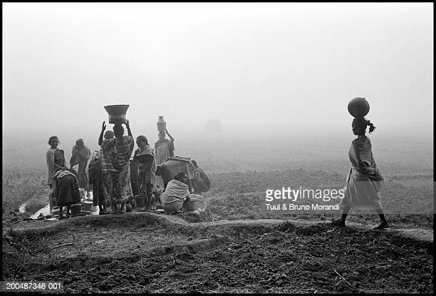 Nepal, Tera, Tharu women at well (B&W)