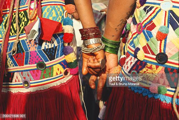 nepal, terai, rana tharu couple holding hands, mid section - terai stock pictures, royalty-free photos & images