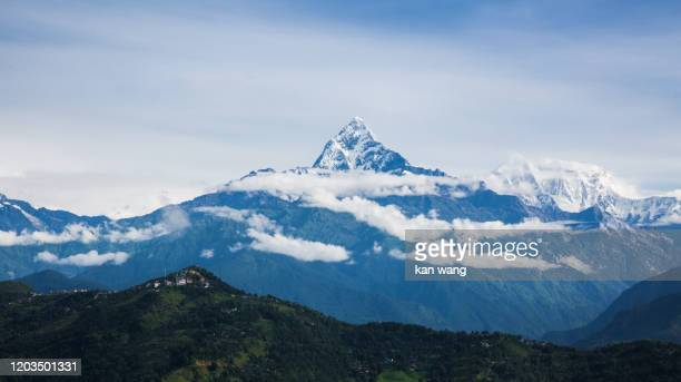 nepal, with the himalayan mountains in the background, including machhapuchare and annapurna - stock photo - kathmandu stock pictures, royalty-free photos & images