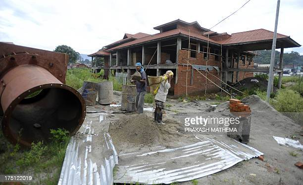 NepalconservationheritageUNESCOreligion by Deepak ADHIKARI Nepalese workers working infront of newly construction house of the electric crematorium...