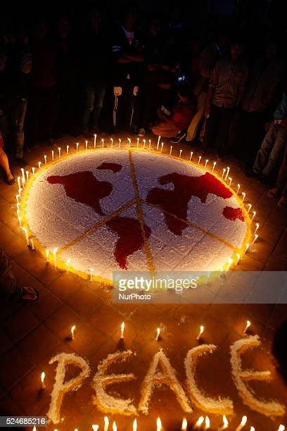 Nepalese activists lights candle during a silent protest against the crisis situation of the country and wish for the world peace in Kathmandu Nepal...