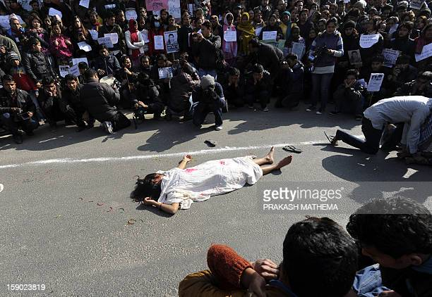 Nepalese activists perform a street drama during a protest near the Prime Minister's residence in Kathmandu on January 6 during a protest demanding...