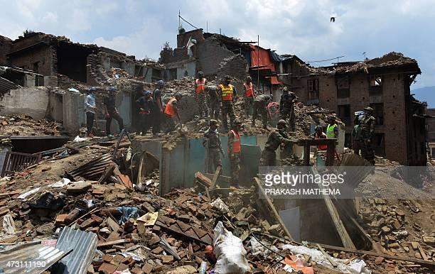 Nepalese and Indian Army rescue personnel search through damaged buildings following an earthquake in Bhaktapur on the outskirts of Kathmandu on May...