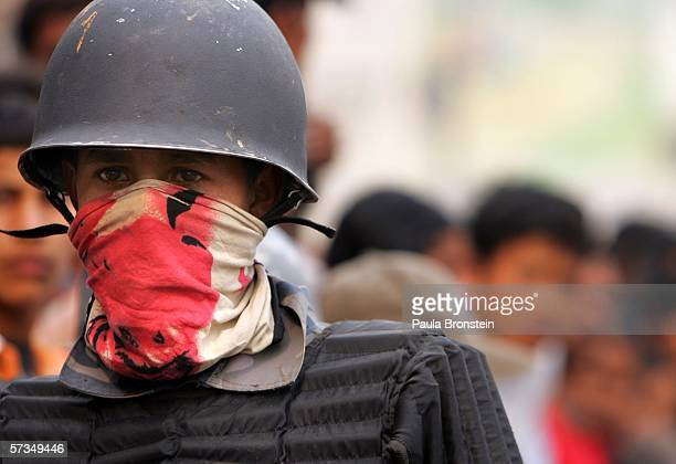 Nepalese armed policeman stands guard during a protest against the rule of King Gyanendra April 17, 2006 in Kathmandu, Nepal. Tensions continue in...