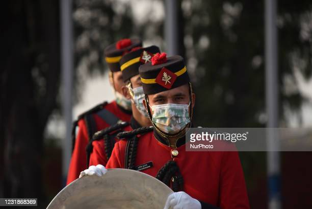 Nepalese Army personnel along with face mask arrive to offer a guard of honor towards President Bidya Devi Bhandari before leave for two-day official...