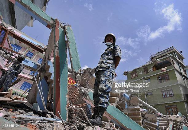 Nepalese army personnel and rescue team looking for the survivors in debris of the building collapsed after a fresh earthquake of 73magnitude hit...