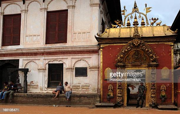 Nepalese army personnel guard a temple on Bhaktapur Durbar Square in Bhaktapur some 12 kilometers southeast of Kathmandu on July 25 2011 Bhaktapur a...