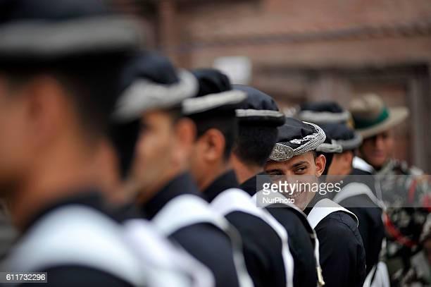 A Nepalese Army Personnel of Gurujuko Paltan smiles during the Gatasthapana first day of Biggest Hindu festival Dashain at Nasal Chowk Basantapur...