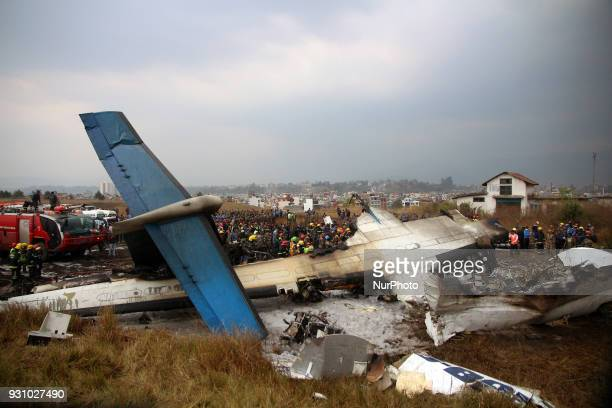 Nepalese army rescue team searchinh on a debris of an airplane that crashed in Kathmandu using crane at Kathmandu Nepal on Monday March 12 2018