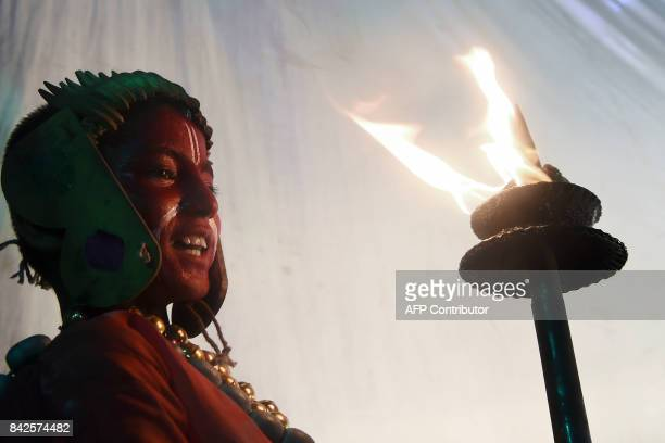 A Nepalese boy with a painted face waits to perform in a play based on the Hindu mythology at the Basantapur Durbar square in Kathmandu on the second...