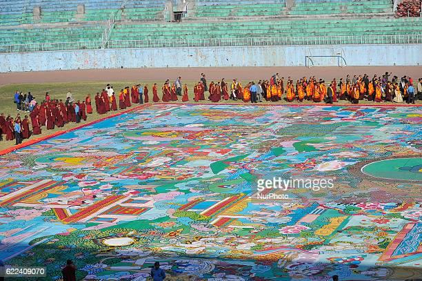 Nepalese Buddhist Kora Arounds World's largest Thangka Painting of 12 important lifestyle of the Lord Gautam Buddha showcased at Dashrath Rangasala...