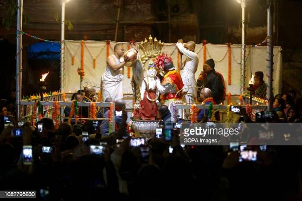 Nepalese Buddhist priests seen performing the rituals at the temple The beginning of the year's chariot festival that is to take place in midApril is...