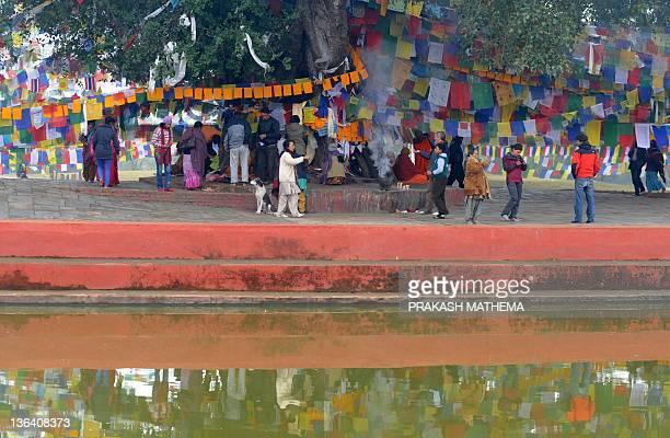 Nepalese Buddhists devotees worship at the Mayadevi temple birth place of Lord Buddha Lumbini 400 kms south west of Kathmandu on January 4 2011Lord...