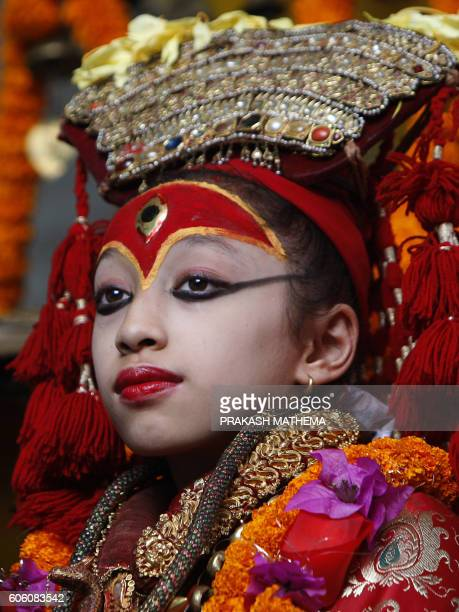 Nepalese child Matina Shakya revered as a living goddess or Kumari is carried during a procession held to honour the Kumari during the fourth day of...