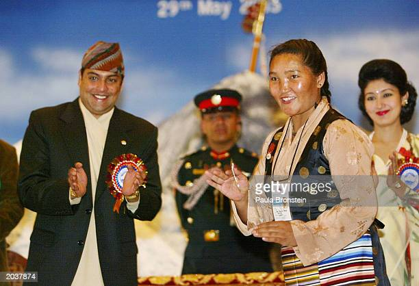 Nepalese Crown Prince Paras Bir Bikram Shah Dev applauds after giving an honor medal to Everest summiter Sherpa Pemba Doma during ceremonies...