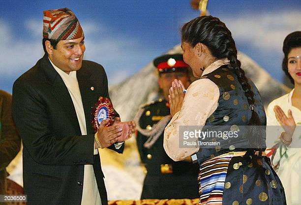 Nepalese Crown Prince Paras Bir Bikram Shah Dev greets Everest summiter Sherpa Pemba Doma during ceremonies celebrating the 50th anniversary of the...