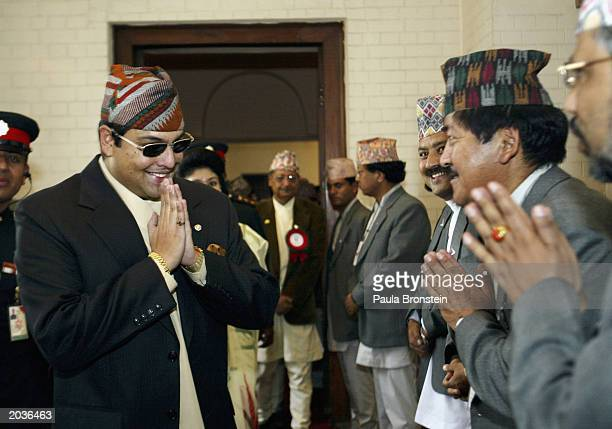 Nepalese Crown Prince Paras Bir Bikram Shah Dev greets officials during ceremonies celebrating the 50th anniversary of the conquering of Mount...