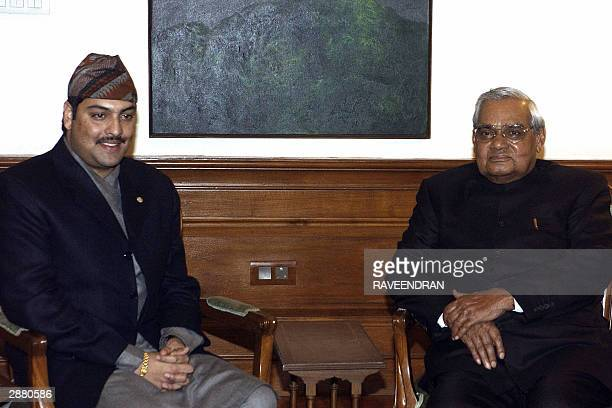 Nepalese Crown Prince Paras Bir Bikram Shah Dev poses with Indian Prime Minister Atal Behari Vajpayee prior to a meeting in New Delhi 19 January 2004...