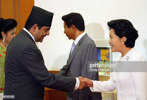 Nepalese Crown Prince Paras Bir Bikram Shah Dev shake hands with South Korea's first lady Kwon YangSook at the presidential house on July 15 2005 in...