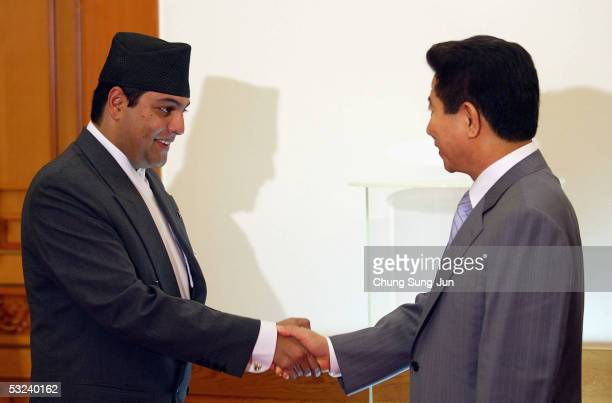 Nepalese Crown Prince Paras Bir Bikram Shah Dev shakes hands with South Korean President Roh MooHyun at the presidential house on July 15 2005 in...