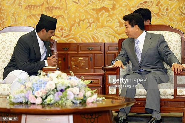 Nepalese Crown Prince Paras Bir Bikram Shah Dev talks with South Korean President Roh MooHyun at the presidential house on July 15 2005 in Seoul...