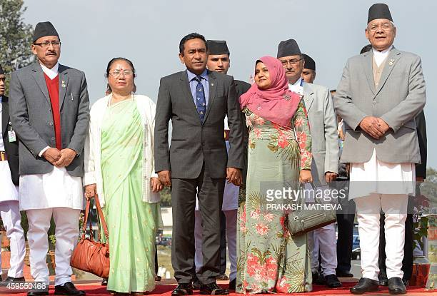 Nepalese Deputy Prime Minister and Home Minister Bam Dev Gautam and Maldivian President Abdulla Yameen Abdul Gayoom pose on his arrival at Tribhuvan...