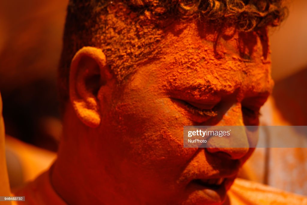 Nepalese devotee covered with vermillion powder Sindoor Jatra festival in Thimi, Nepal, April 15, 2018. Devotees mark the festival by playing traditional drums, singing, dancing and carrying chariot of various deities around town while throwing vermillion powder to welcome the advent of spring and the New Year.