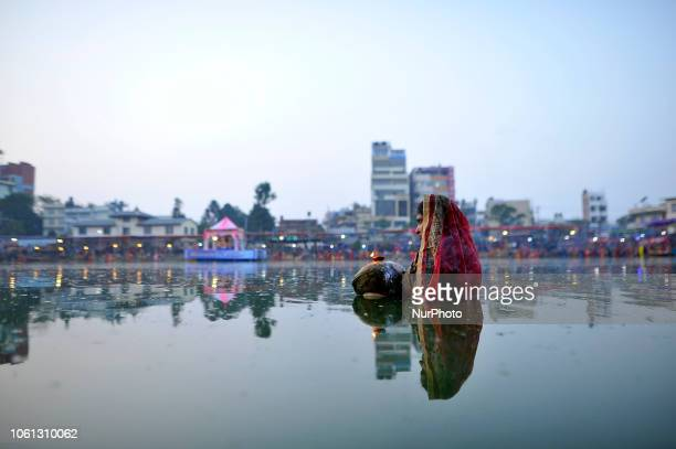 A Nepalese Devotee dip in the pond and awaits for the rising sun on the fourth and last day of Chhath Puja Festival at Bagmati River Kathmandu Nepal...