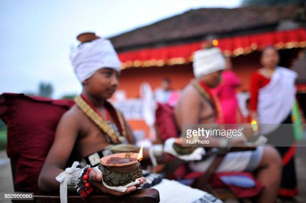Nepalese devotee hold oil lamps on their body during the tenth day of Dashain Durga Puja Festival in Bramayani Temple Bhaktapur Nepal on September 30...