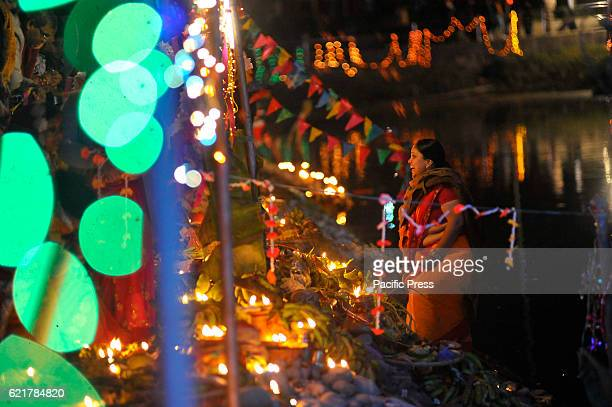 Nepalese devotee lit up fragrance sticks during Chhath Puja Festival at Kamal Pokhari. Chhath Puja Festival, the worship of Sun God, is common in...