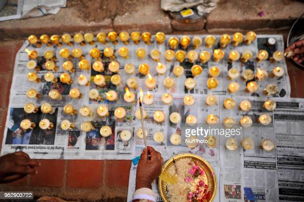 Nepalese devotee offering 108 butter lamps at the premises of Chiloncho Stupa during celebration of Buddha Purnima festival Birth Anniversary of Lord...