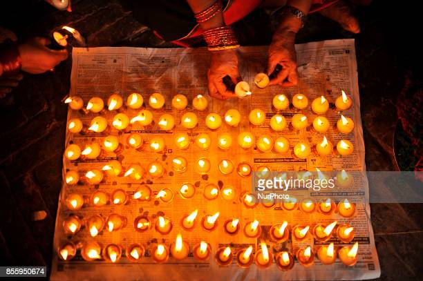 Nepalese Devotee offering butter lamps infornt Bramayani Temple during the tenth day of Dashain Durga Puja Festival in Bramayani Temple Bhaktapur...