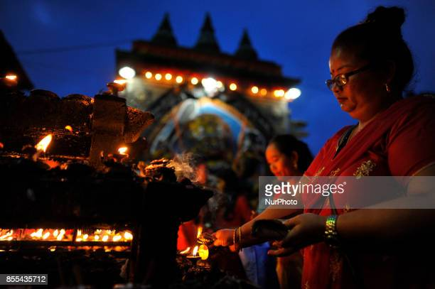 Nepalese Devotee offering butter lamps infornt of Kaal Bhairab on the occasion of Navami ninth day of Dashain Festival at Basantapur Durbar Square...