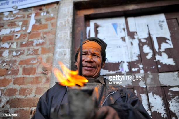 A Nepalese devotee offering oil lamp during the celebration of Mahalaxmi Festival at Thankot Kathmandu Nepal on Sunday November 05 2017 Mahalaxmi...