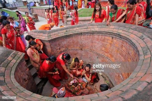 Nepalese devotee offering ritual prayer during Teej festival celebrations at Pashupatinath Temple Kathmandu Nepal on Thursday August 24 2017 The Teej...