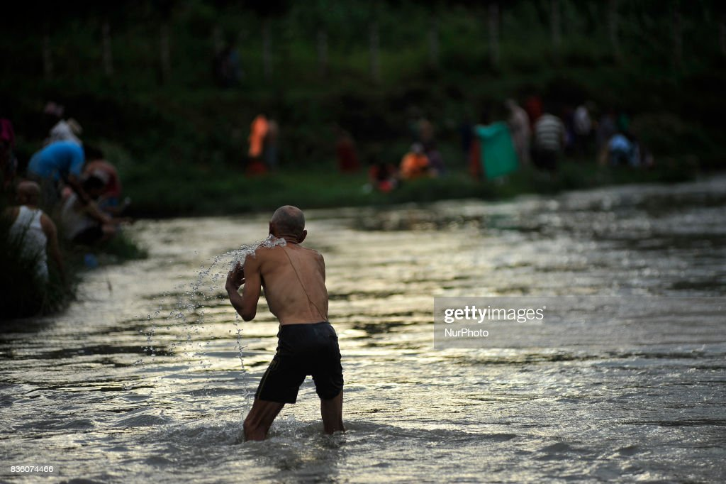 Nepalese devotee takes the ritual holy bath on the banks of the Bagmati River during the celebration of Kuse Aunsi or Father's Day at Gokarna Temple in Kathmandu, Nepal on Monday, August 21, 2017. On the day of the new moon, families also pay their respects to their deceased fathers.