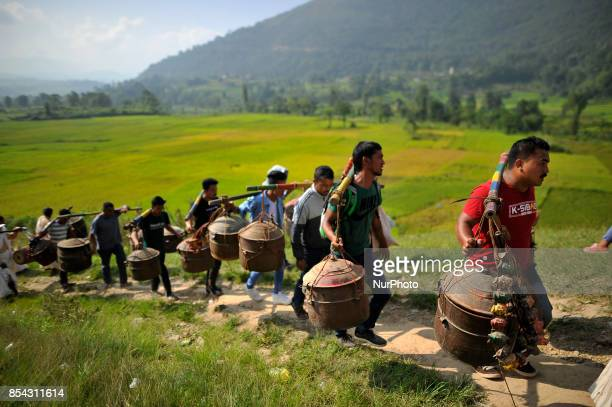 Nepalese devotees carrying maks of deity for the celebration Shikali Festival at Khokana Village Patan Nepal on Tuesday September 26 2017 People...