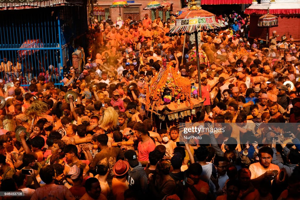 Nepalese devotees dance and play traditional drums carrying palanquin with idol of Hindu deities during Sindoor Jatra festival in Thimi, Nepal, April 15, 2018. Devotees mark the festival by playing traditional drums, singing, dancing and carrying chariot of various deities around town while throwing vermillion powder to welcome the advent of spring and the New Year.